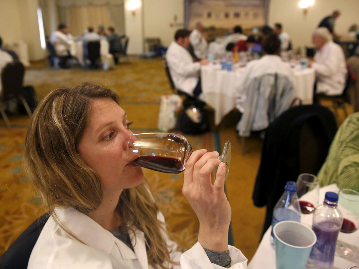 Judge Ashley Holland tastes a wine in a category of unusual red varietals during the North Coast Wine Challenge judging at the Hilton Sonoma Wine Country Hotel in Santa Rosa, on Tuesday, April 12, 2016. (BETH SCHLANKER/ The Press Democrat)