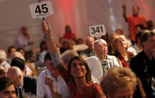Eva Bertran of Gloria Ferrer holds her bidding paddle high for the Fund-a-Future segment of the Sonoma Harvest Wine Auction to support children in the local community, at Chateau St. Jean in Kenwood, California on Sunday, September 4, 2016. (Alvin Jornada / The Press Democrat)